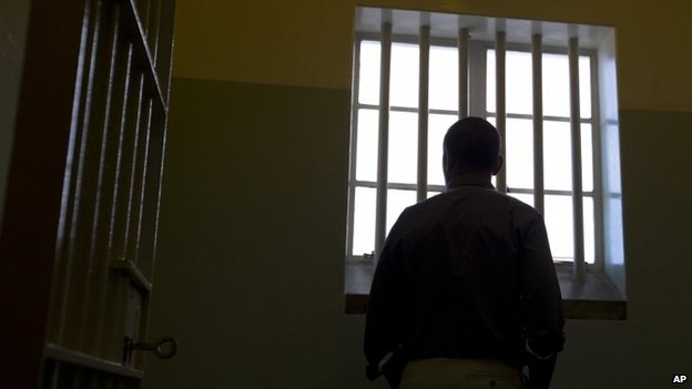 President Obama in Nelson Mandela's former cell on Robben Island, 20 June 2013