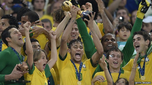 Brazil players celebrate with trophy