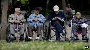 File photo: a group of elderly men take a rest on their wheelchairs at a park in Beijing on 23 May 2013