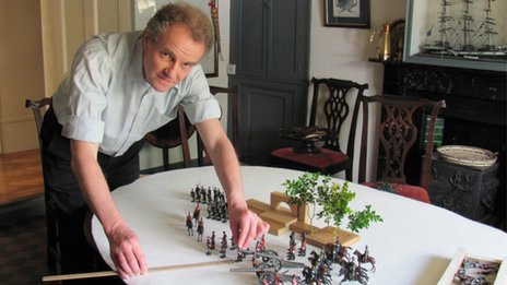 Prof Dominic Wells with toy soldiers