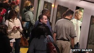 Commuters board a Bay Area Rapid Transit (BART) train during rush hour on 29 October 2009