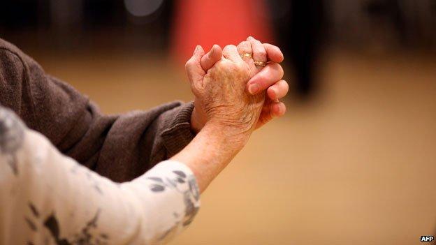 Elderly people dancing