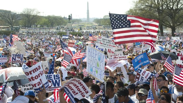 Tens of thousands of immigration reform supporters march in the 'Rally for Citizenship' on the West Lawn of the US Capitol in Washington, DC