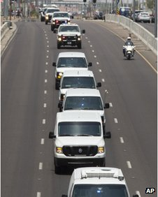 Procession carries the bodies of 19 firefighters to Phoenix, Arizona 1 July 2013
