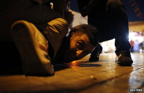A protester is pinned down by plainclothes police in Taksim Square, Istanbul, 29 June