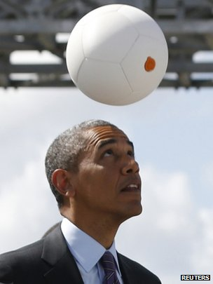 "US President Barack Obama heads a ""soccet ball"" at Ubungo Power Plant in Dar es Salaam on 2 July 2013"