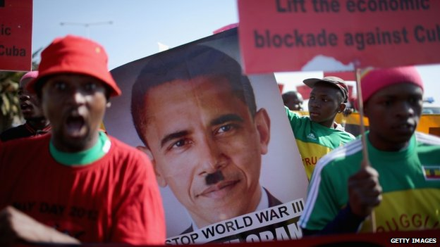 Protesters gather outside Johannesburg University in Soweto in advance of President Obama's meeting with students on  29 June  2013 in Johannesburg, South Africa