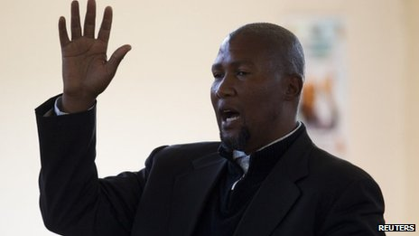 Mandla Mandela, grandson of former South African President Nelson Mandela, sings during a church service near the home of the former president in Qunu on 30 June 2013
