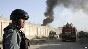 An Afghan security force member stands guard near the entrance gate of a compound following a suicide bombing in Kabul, Afghanistan on 2 July 2013