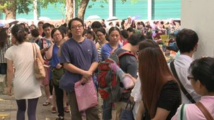 Parents waiting for results of their children's admission to a school in Hong Kong