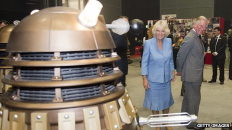 Prince Charles and the Duchess of Cornwall meet a Dalek