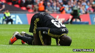 Demba Ba praying after scoring for Chelsea at Wembley