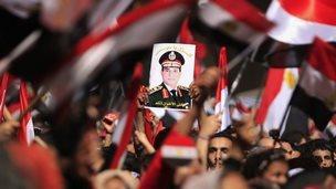 Opposition protesters hold up a poster of General Abdul Fattah al-Sisi in Tahrir Square (3 July 2013)