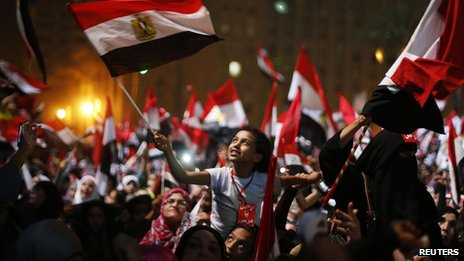 Protesters react to news of coup in Tahrir Square, Cairo