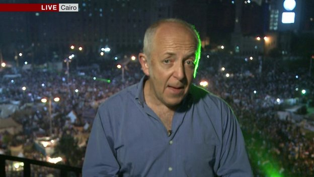 Jeremy Bowen picked out by laser pen in Tahrir Square