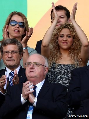 Shakira, right, applauds at the Confederations Cup match between Italy and Spain