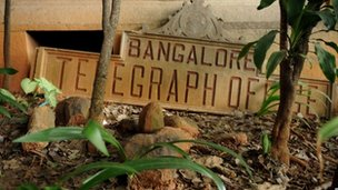 A derelict name board for the Bangalore Telegraph office lies on the ground outside the telecommunications office premises in Bangalore