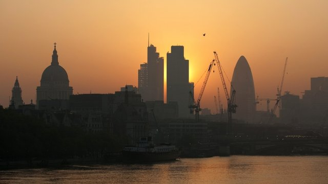 Sun rises over City of London
