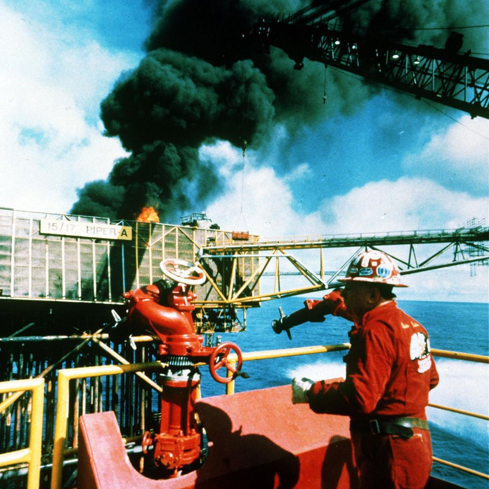 Texan firefighter Red Adair on the still-burning Piper Alpha offshore platform