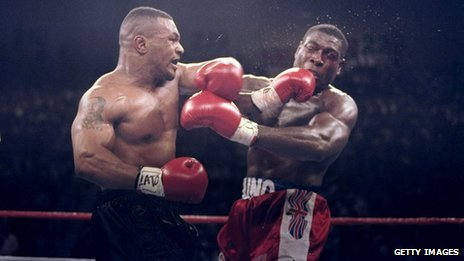 Mike Tyson lands a left punch on Frank Bruno at the WBC Heavyweight Championship on March 16, 1996