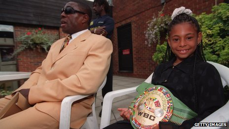 Rachel Bruno displays the WBC World Heavyweight belt that Frank Bruno won in 1995