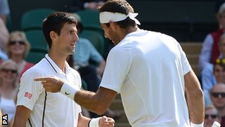 Novak Djokovic and Juan Martin del Potro have a chat after a point