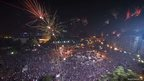Fireworks light up the sky as thousands of Egyptians celebrate in Tahrir Square