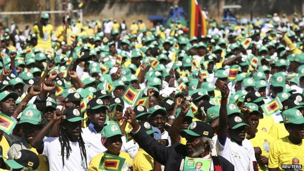 Supporters cheer Zimbabwean President Robert Mugabe as he arrives to launch his ruling Zanu-PF election campaign - 5 July 2013