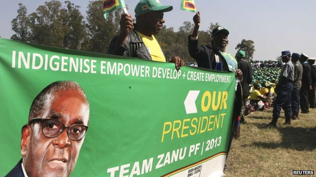 Supporters cheer Zimbabwean President Robert Mugabe at the launch of the Zanu-PF election - 5 July 2013