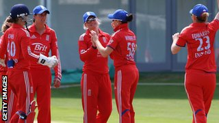 England's Susie Rowe (centre) is congratulated after a run-out
