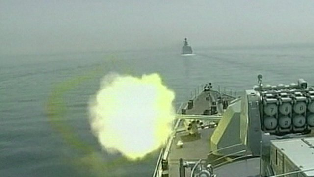 Rounds are fired from a ship during a joint naval exercise between China and Russia