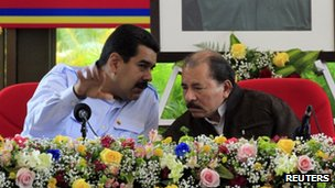 Venezuela's President Nicolas Maduro (L) speaks with Nicaragua's President Daniel Ortega