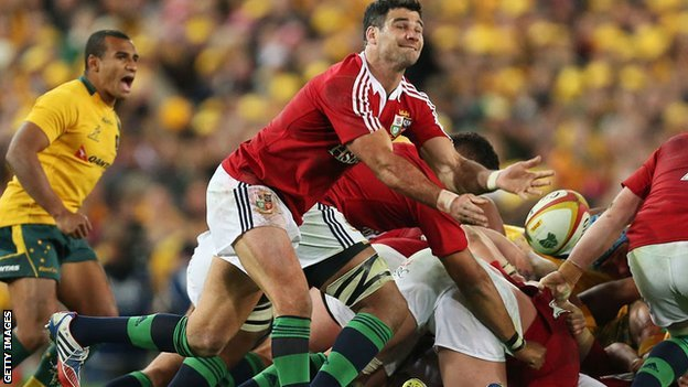 Mike Phillips passes from the base of a scrum for the Lions against Australia as Will Genia looks on