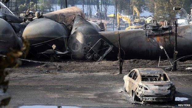 Destroyed oil containers are seen after the train derailment in Lac-Megantic, Canada, 7 July 2013
