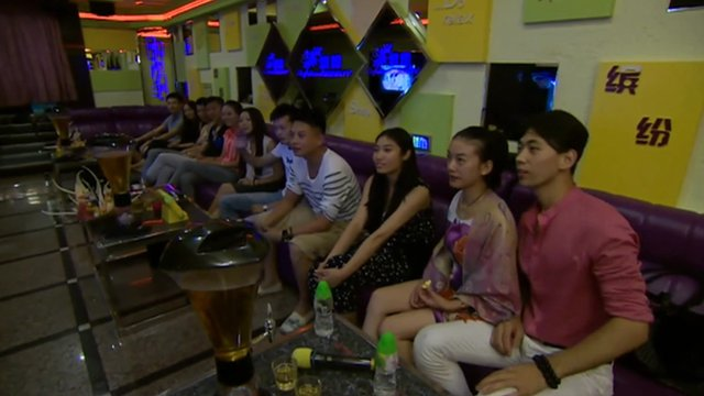 Chinese graduates in karaoke bar
