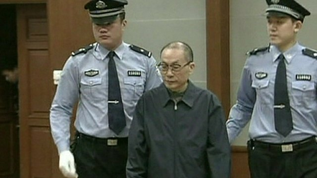 Liu Zhijun is escorted into court