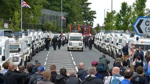 Orange Order marchers make their way past Ardoyne in Belfast last July