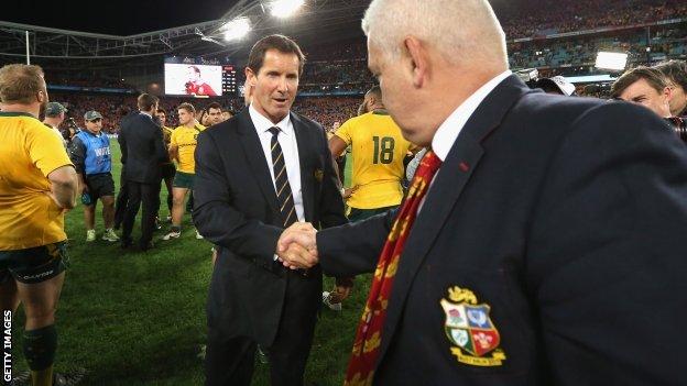 Robbie Deans congratulates Lions coach Warren Gatland
