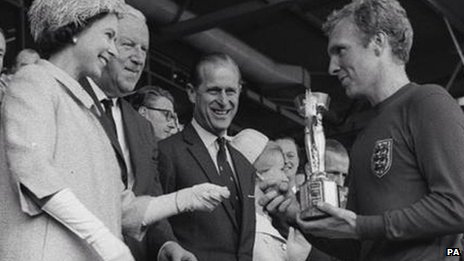 Bobby Moore receives the World Cup from the Queen in 1966