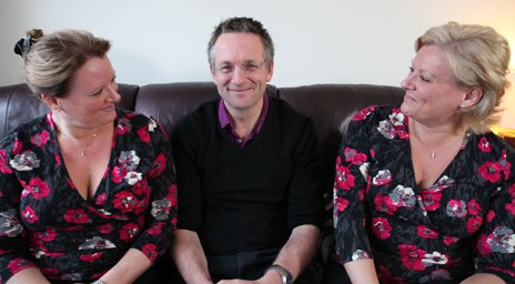 Michael Mosley sitting in the middle of twins Debbie and Trudi