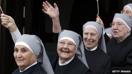 Four Catholic nuns in a row
