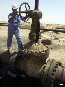 Oil worker near pipeline in Basra, Iraq, in 2004