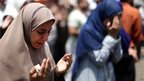 Women pray at the Rabaa al-Adawiya mosque in Cairo (8 July 2013)