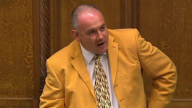 Robert Halfon in tangerine-coloured suit