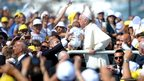 Pope Francis kisses a baby during his visit to the island of Lampedusa