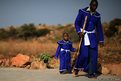 A man and a child walk to prayers on top of Melville Koppies  in Johannesburg, South Africa