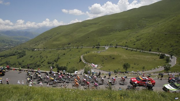Riders in the Tour de France going through a Pyrenees stage