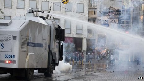 Turkish police fire a water cannon at protesters in Istanbul (8 July 2013)
