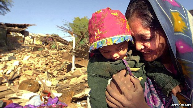 Woman cries in front of her destroyed home in Bhuj, western India