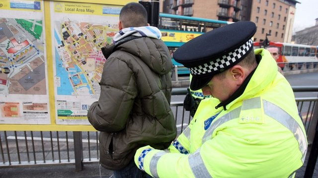 Police officers, combating potential knife-crime, stop and search people arriving in Liverpool by bus